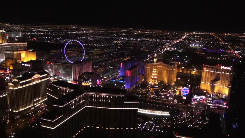 """Aerial Vegas Bellagio Fountains, Paris Hotel, and High Roller """"Observation Wheel""""  Aerial imagery of the Las Vegas Strip,  the High Roller, the Linq , as well as the classic Bellagio Fountains."""