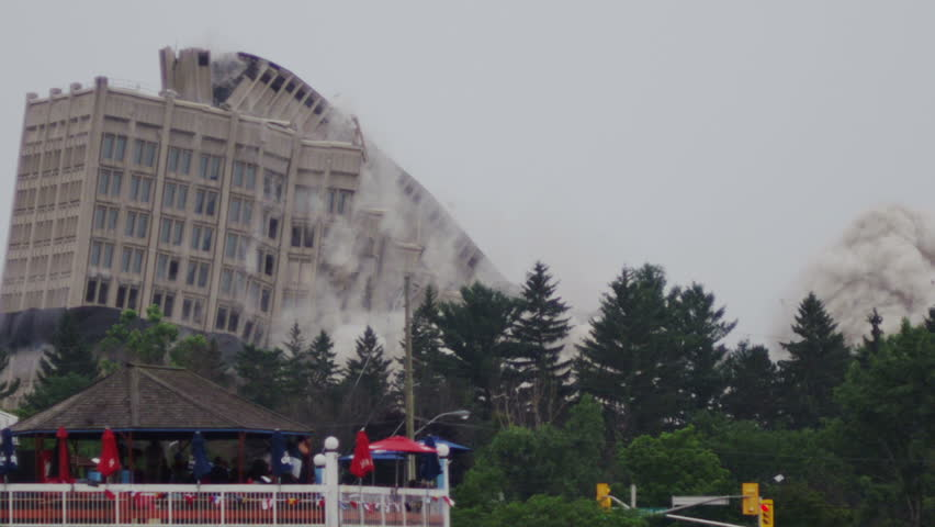 Demolition of Building - Old Structure Collapses and Kicks up a Huge Cloud of Dust