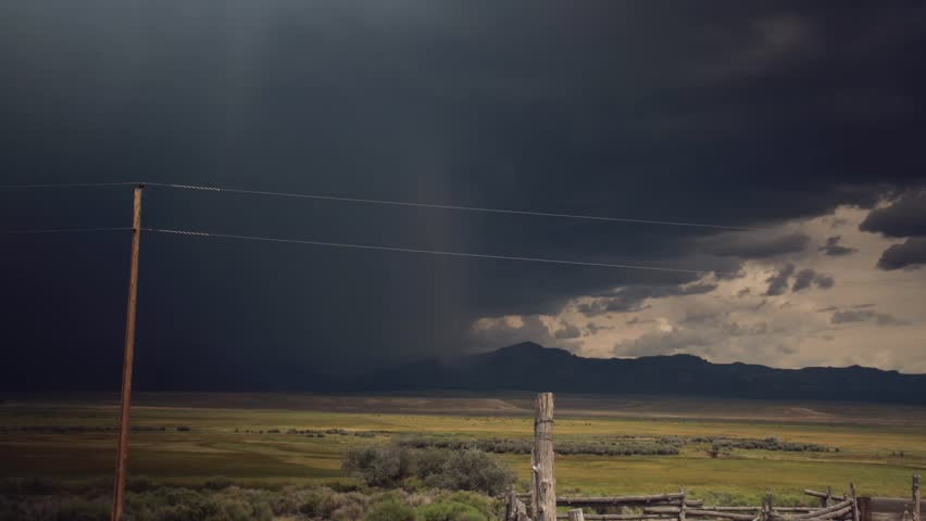 Wide angle view of landscape on a rainy day, mountains in background | Shutterstock HD Video #6813292