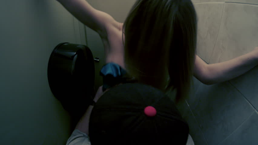 Couple making love in a bathroom stall at a club or bar   Shutterstock HD Video #6813595