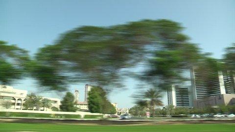 DUBAI, UNITED ARAB EMIRATES - JUNE 2014 Camera is in the car, shooting Dubai Streets