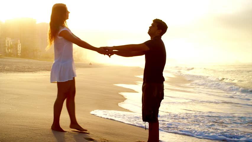 Loving couple embrace on a beach   Shutterstock HD Video #6834877