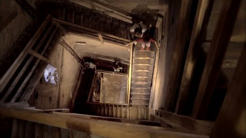 Family climbs the stairs of the Asinelli tower in the  to see the panoramic view of Bologna Italy