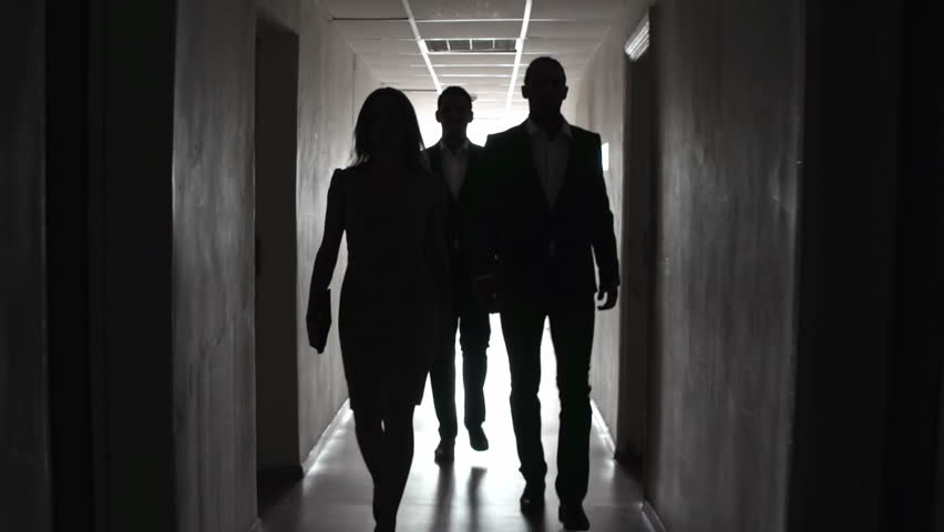 Group of people approaching camera in the dark hallway | Shutterstock HD Video #6854320