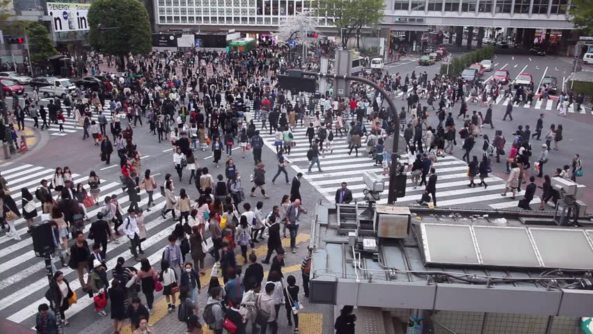 TOKYO, JAPAN - CIRCA APRIL 2014: People crossing the street, pedestrians walking, traffic. Shibuya Crossing, one of the busiest intersections in the world circa April 2014 in Tokyo, Japan, Asia #6854902