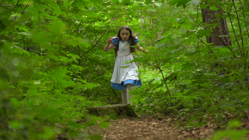 Alice in Wonderland is scared and running away from something - slow motion