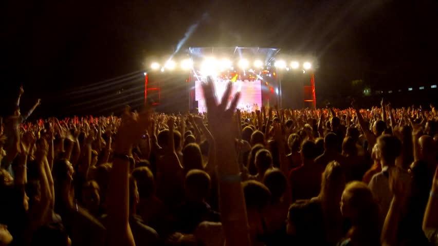 Crowd at a rock concert, back light silhouette    Shutterstock HD Video #6875380