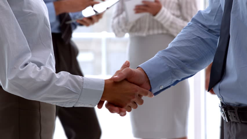Business team shaking hands close up in slow motion #6877522