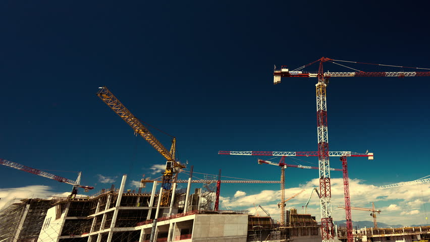 Big construction site with cranes with pan and zoom effect.