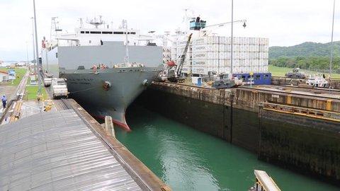 Panama Canal, Circa 2014:Long distance shot of a large ship passing through the Panama Canal, Circa 2014.