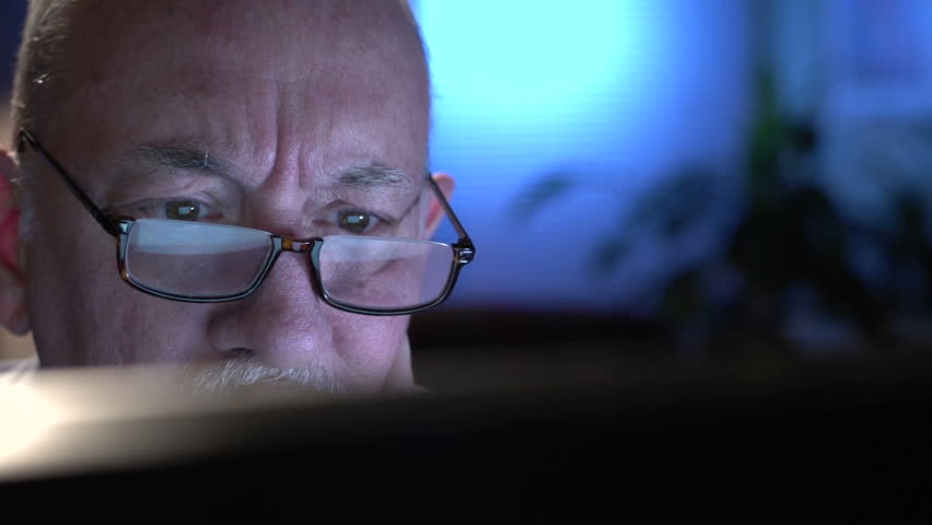 Frustrated older man at computer, close up