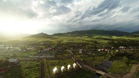 Aerial Stock Footage Flight From Dawn Over Mountain Village