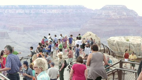 JULY 1, 2014 - GRAND CANYON, AZ - Tourists overlook the Grand Canyon from the South Rim. With over 5 million visitors per year, the Grand Canyon is one of the top tourist destination in the world.
