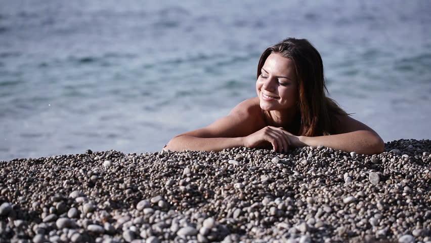 Naked Girl On Pebble Beach Stock Footage Video (100%