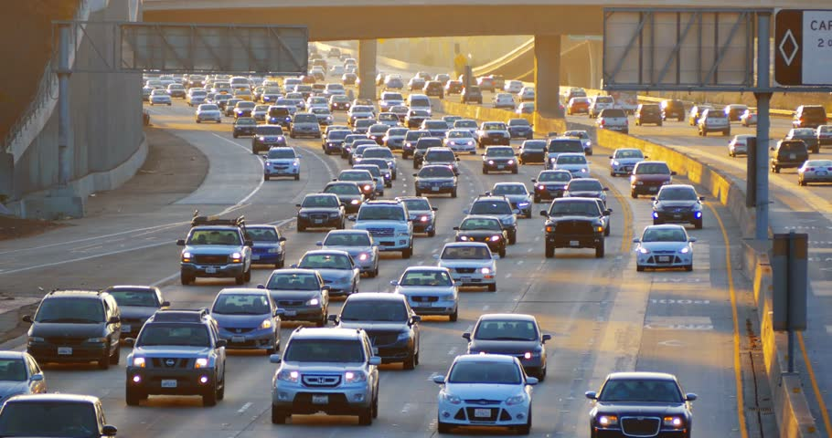 Cars driving in traffic jam on 405 freeway in Los Angeles, California. 4K.