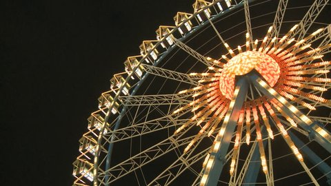 Close-Up Nightshot of the Big Ferry Wheel at the Oktoberfest in Munich