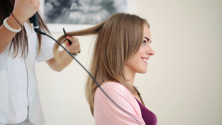 Hairdresser Using Straightener On Beautiful Stock Footage Video 100 Royalty Free 7015252 Shutterstock