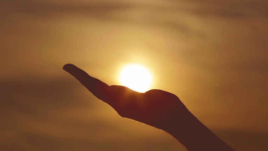 The hand takes and hold the sun. | Shutterstock HD Video #7054882
