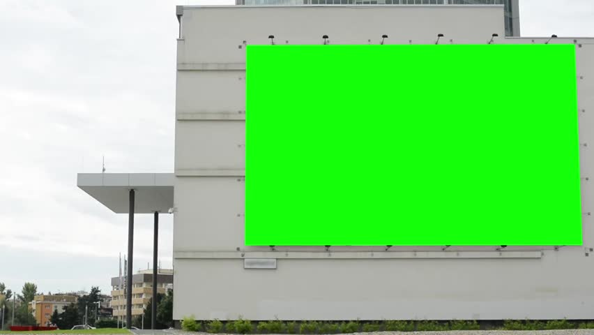 Billboard on a building (shopping center) - green screen - with people in background - cloudy sky - buildings with nature in background | Shutterstock HD Video #7071379