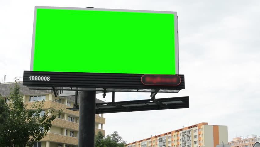 Billboard in the city near road - green screen - buildings with trees in background  | Shutterstock HD Video #7071403