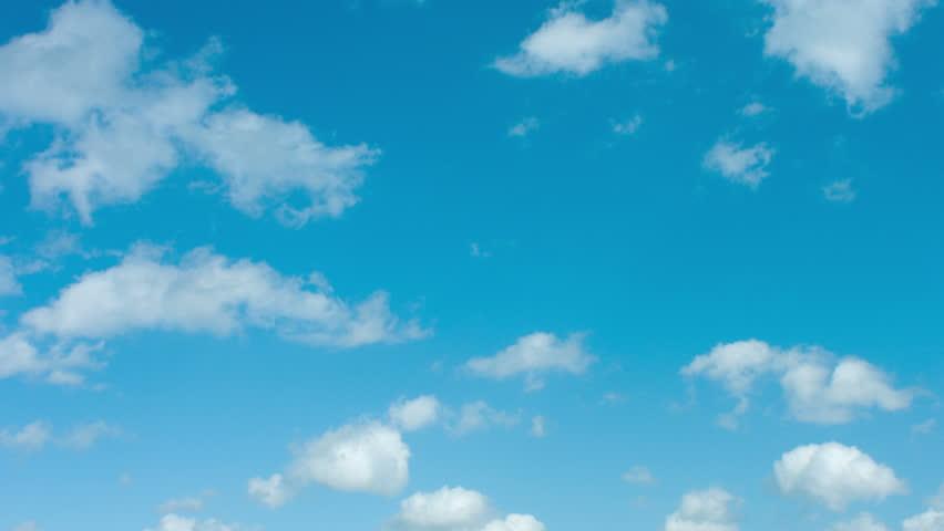 Clouds timelapse on blue sky, shot in RAW 4K UltraHD | Shutterstock HD Video #7084426