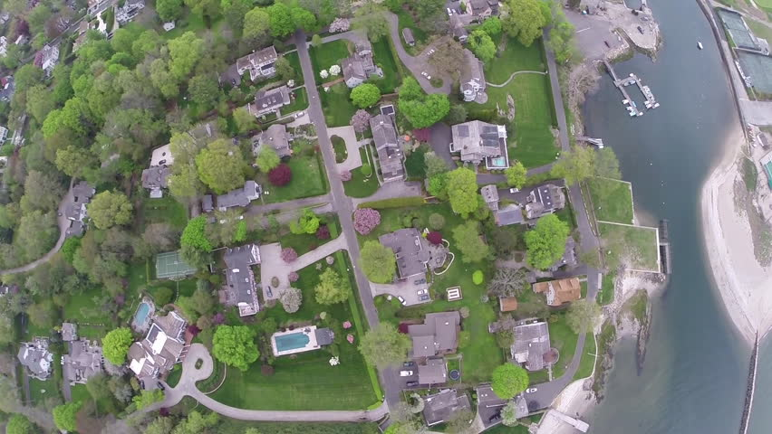 Birdseye, sky high aerial view of luxury suburban homes and the Southport Harbor in Fairfield, Connecticut. Circa June 2014.