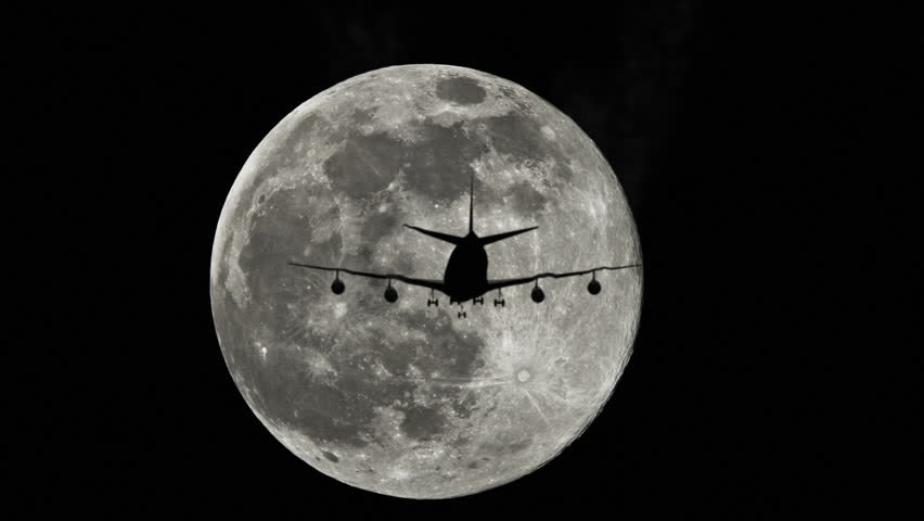 Plane silhouette against a full moon in the sky, airplane flying by the moon   Shutterstock HD Video #7086946