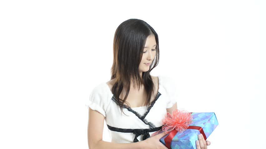 Smiling woman with a gift | Shutterstock HD Video #7109935