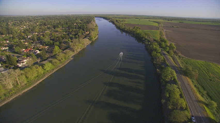 CIRCA 2010s - Aerial over a boat on the Sacramento or American River in California.