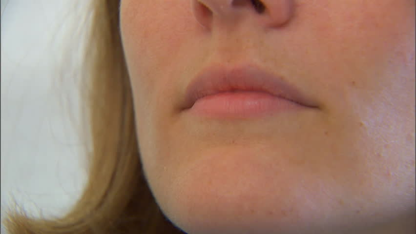 CIRCA 2010s - A doctor treats a patient for flu like symptoms. | Shutterstock HD Video #7111048