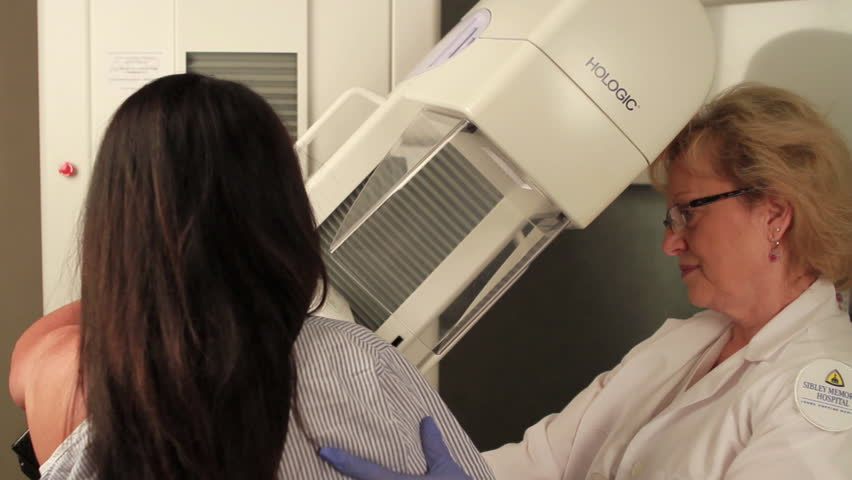 CIRCA 2010s - A woman receives a digital mammogram.