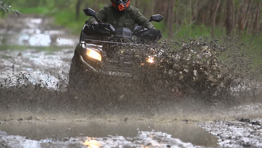ATV on muddy road