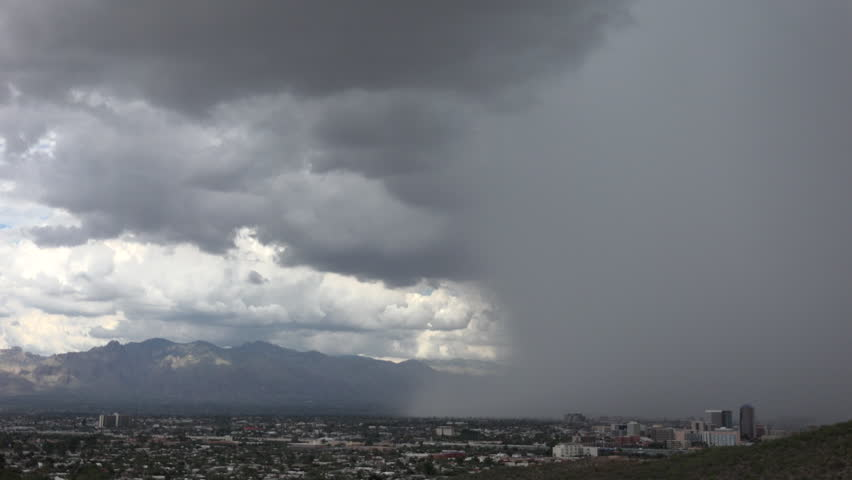 Dramatic rain shaft, sandstorm, lightning bolt sweeps over mountains, city of Tucson, Arizona during summer monsoon storm. 4K UHD 3840x2160