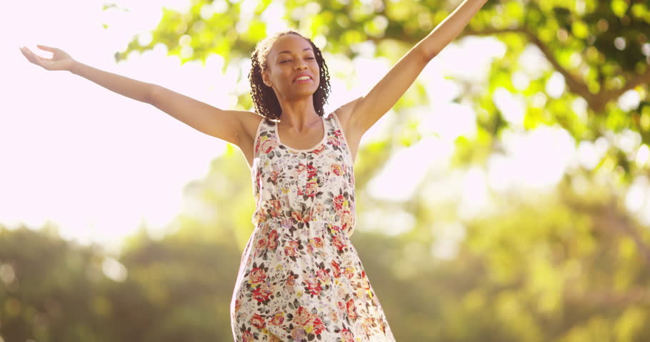 Attractive black woman standing in a park