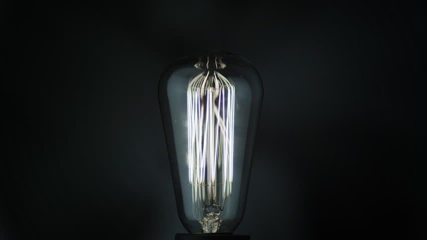 Light bulb on Dark Background.  Shot on RED Cinema Camera in 4K, so you can easily crop, rotate and zoom, without loosing quality. ProResHQ codec - Great for editing, color correction and grading.