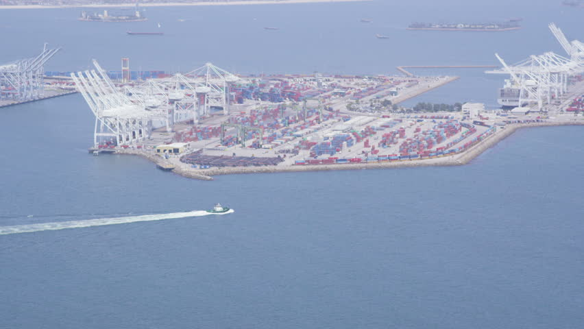 Aerial view of Los Angeles shipping port docks.  Cargo ships loaded with containers and oil. Helicopter shot circling boats and cranes. | Shutterstock HD Video #7223380