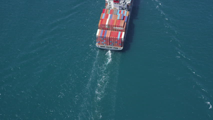 Aerial shot of container ship in at sea near Los Angeles container shipping Port | Shutterstock HD Video #7223383