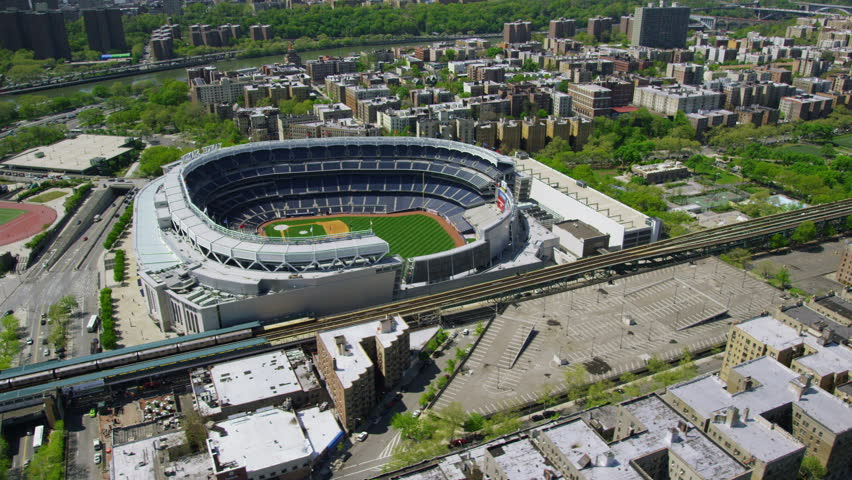 Aerial view of Yankee Stadium in downtown New York City. Helicopter shot of iconic American ballgame arena