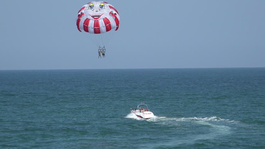 VARNA, BULGARIA - AUGUST 1, 2014: Balloon, parachute over the sea. Shot in 4K (ultra-high definition (UHD)), so you can easily crop, rotate and zoom, without losing quality! Real time.