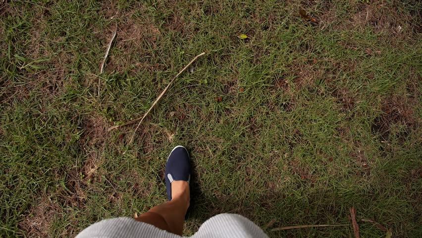 Female Legs in Street Slippers Walking on Green Grass. Slow Motion. HD, 1920x1080. | Shutterstock HD Video #7250452