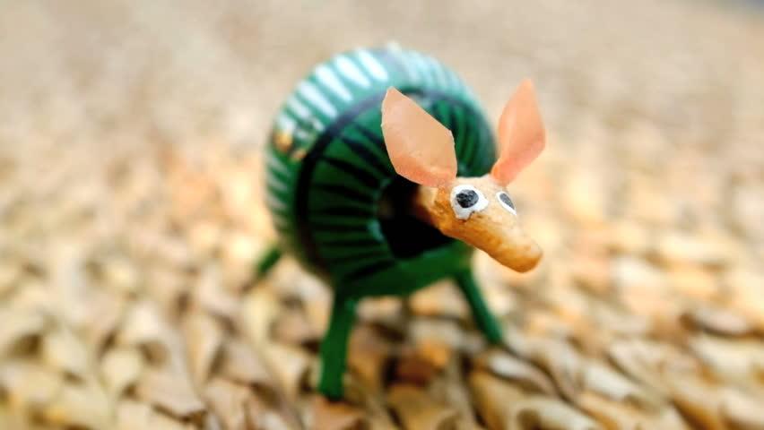 Traditional Mexican folk art toy bobblehead armadillo