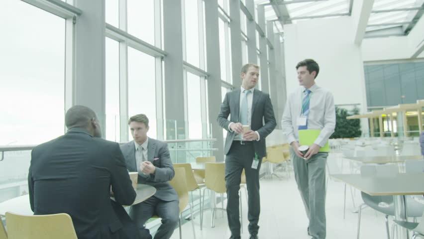 Business people take a break in large office cafe area | Shutterstock HD Video #7271014