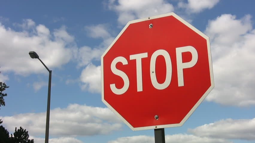 Stop sign with timelapse clouds. HD. | Shutterstock HD Video #728236