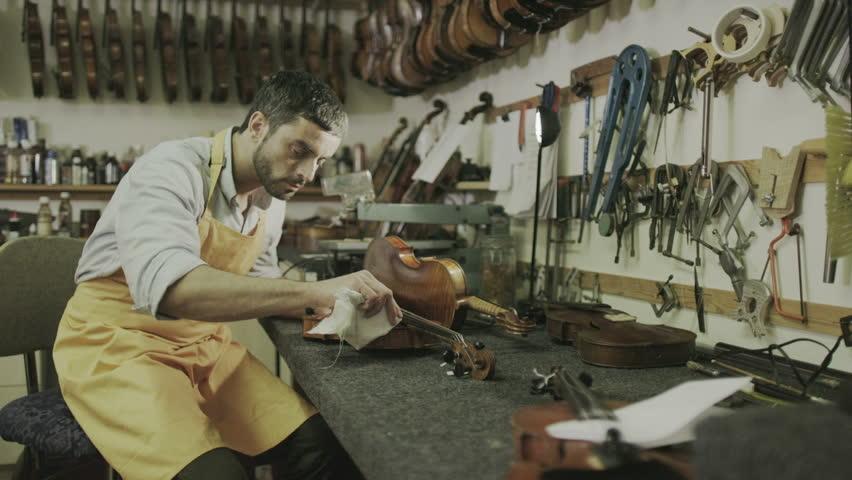 Craftsman in his workshop, making and restoring violins   Shutterstock HD Video #7315597