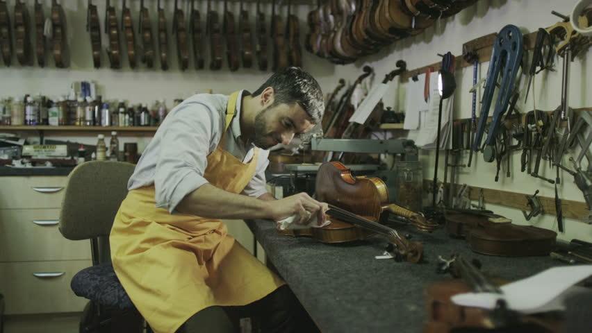 Craftsman in his workshop, making and restoring violins   Shutterstock HD Video #7315663