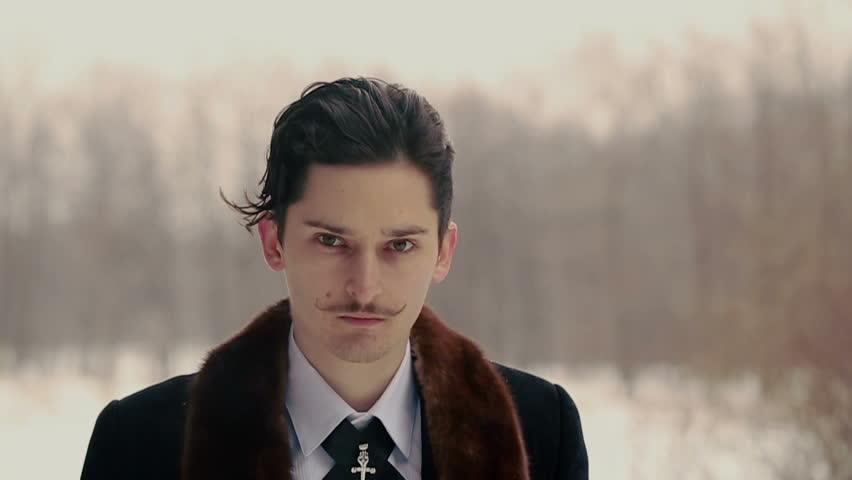 Gentleman Goes Straight Through the Snowy Nature   Shutterstock HD Video #7328944