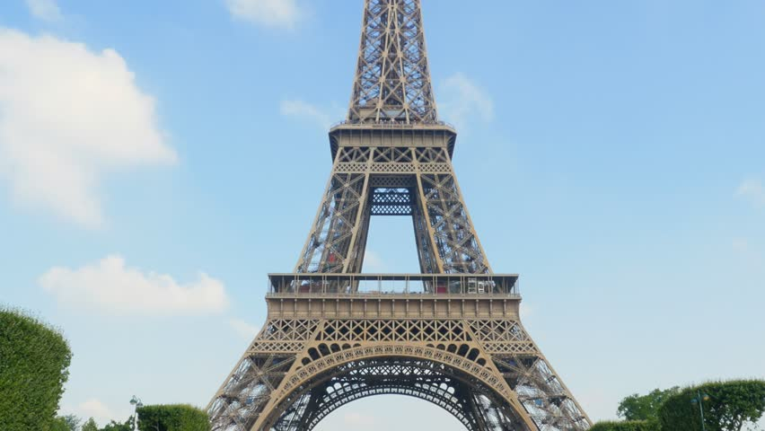 eiffel tower tilt from champs de mars sunny day uhd 4k #7354153