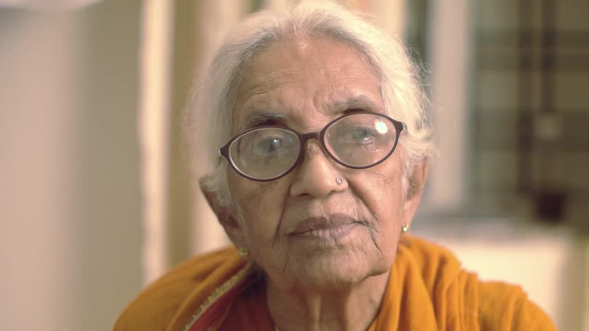 A very old Indian / Asian woman smiling laughing and giggling  | Shutterstock HD Video #7363858