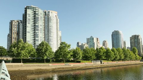 Yaletown Seawall Morning Workout. People use the seawall in front of the Yaletown condominiums in downtown Vancouver. British Columbia, Canada.