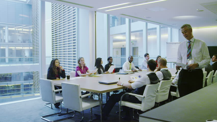 Business team in boardroom meeting in a large modern office building | Shutterstock HD Video #7372096
